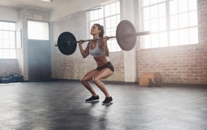 5 Variations On Weightlifting Squats To Switch Up Your Leg Day